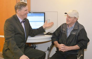Radiation oncologist Dr. Glenn Healey consults with a patient at the Harold Alfond Center for Cancer Care.
