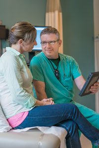 MaineGeneral surgeon Ian Reight, MD consults with a patient before her scheduled procedure.
